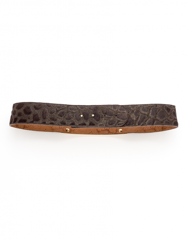 Brown belt with decorative metal pieces