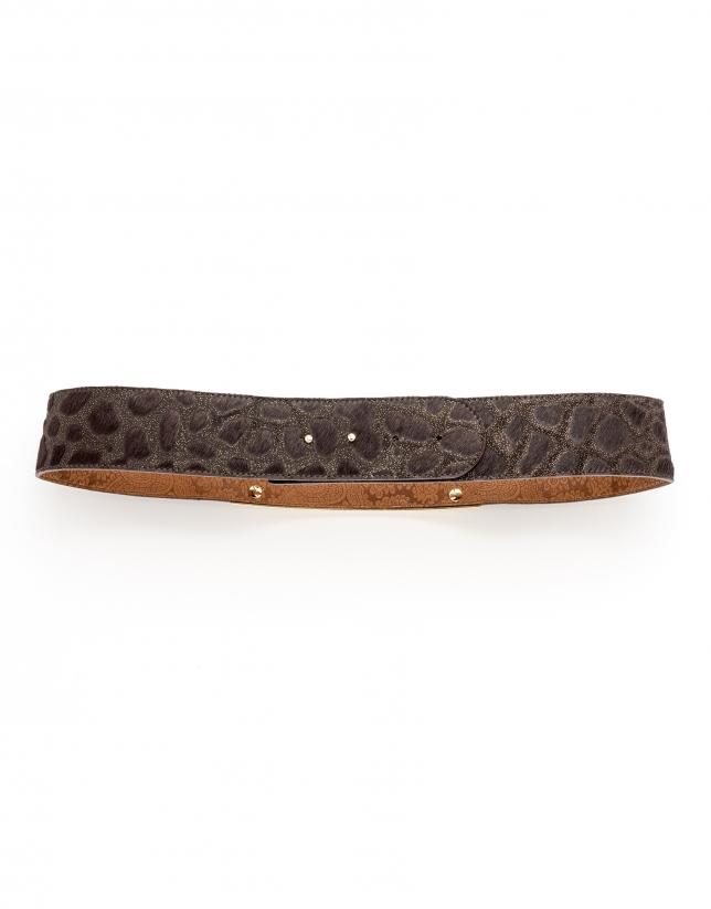 Brown belt with decorative metal pieces