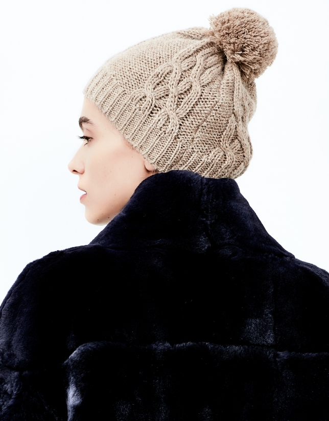 Beige knit cap with pompom