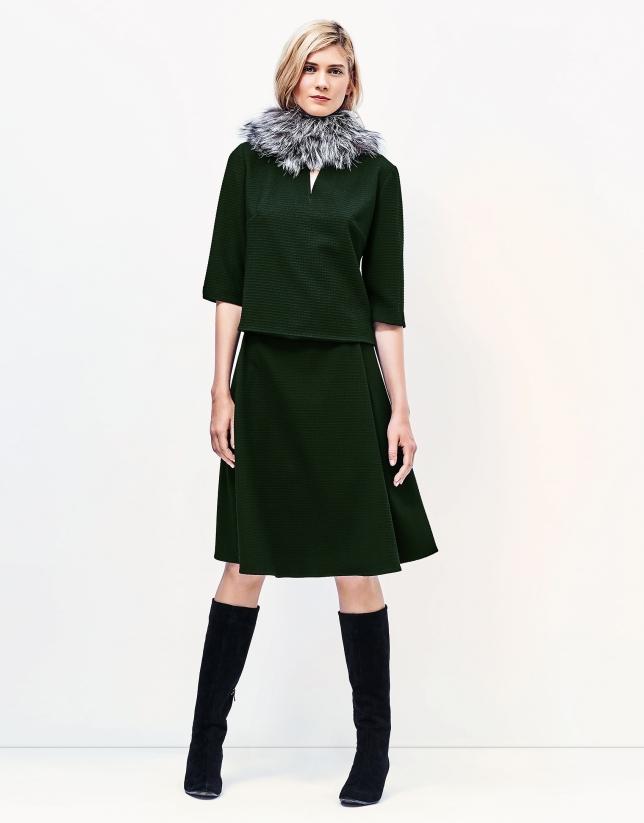 Green top with round neckline