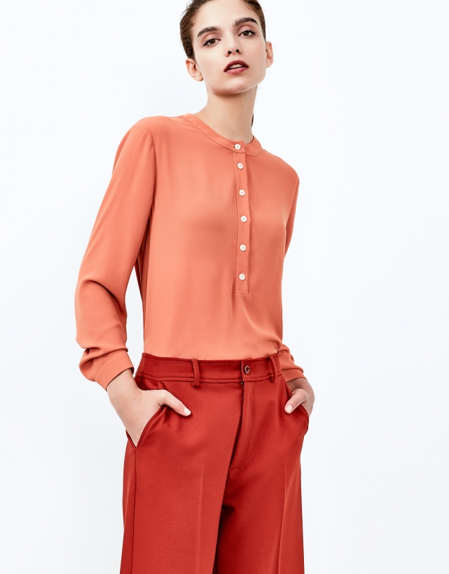 Brick red blouse with round neckline