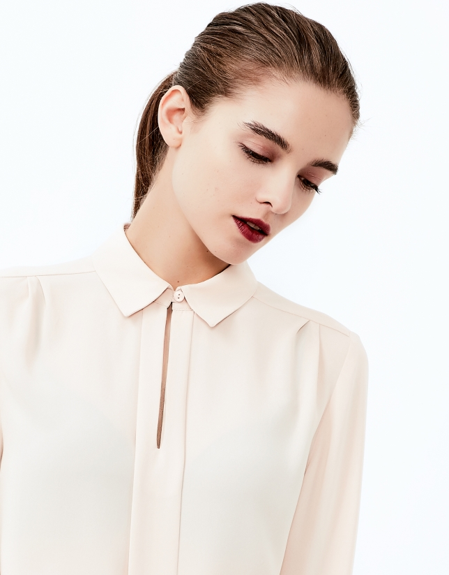 Beige shirt with central pleat