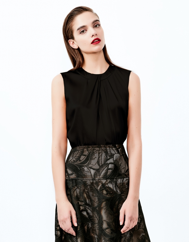 Black top with decorative folds