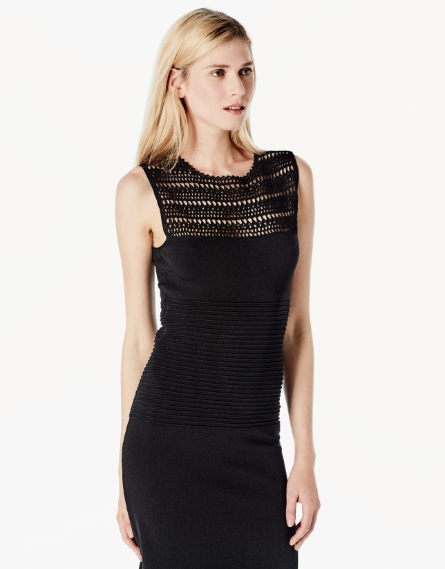 Long black knit dress with openwork
