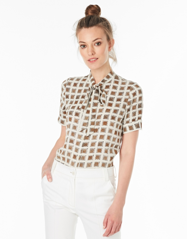 Beige top with bow