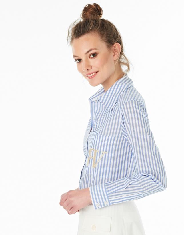 Chemisier avec une poche à rayures en bleu et blanc