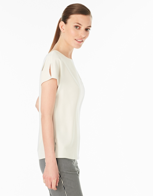 Cream-colored top with pocket