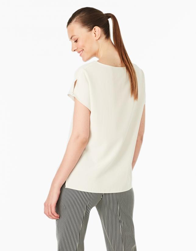 Camiseta bolsillo crema