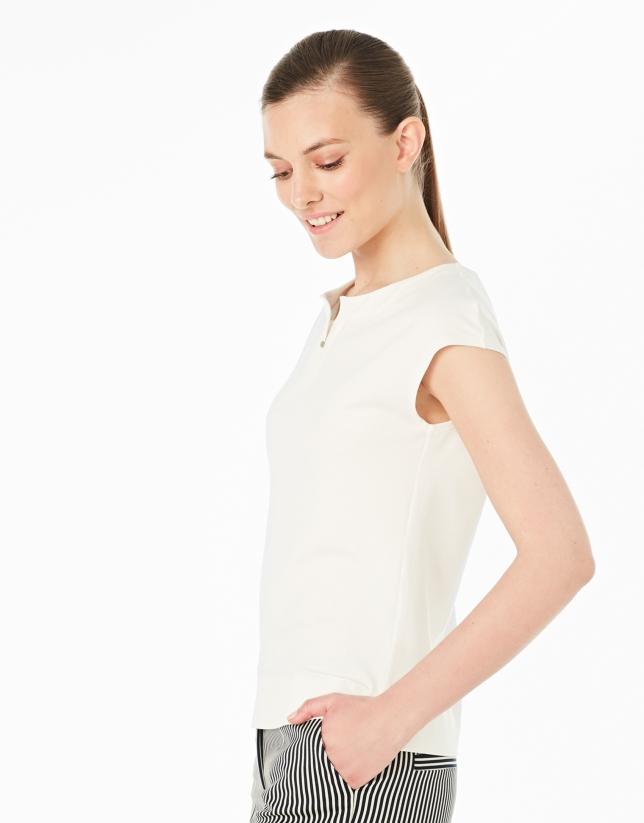 Cream-colored sleeveless top