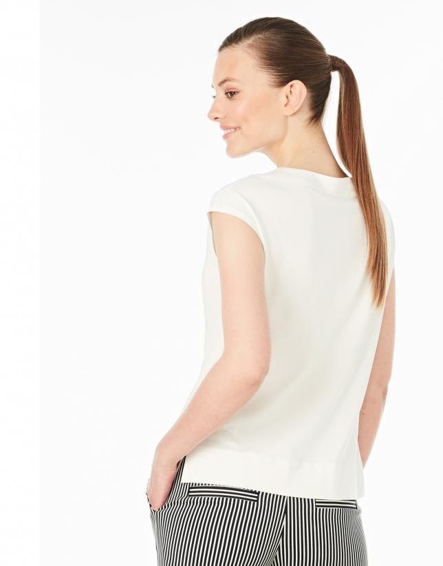 Camiseta sin mangas crema