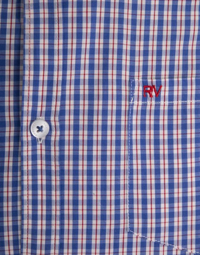 Chemise décontractée à carreaux blanc et bleu profilée en rouge