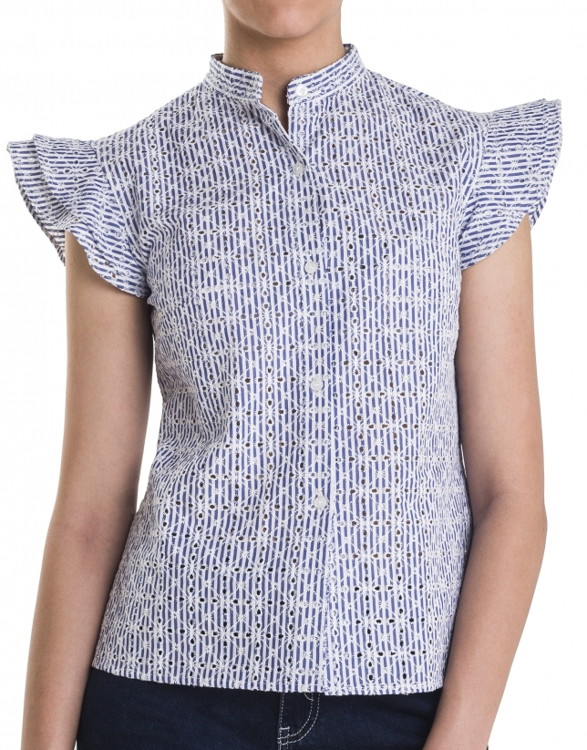 Blue embroidered shirt with flounces