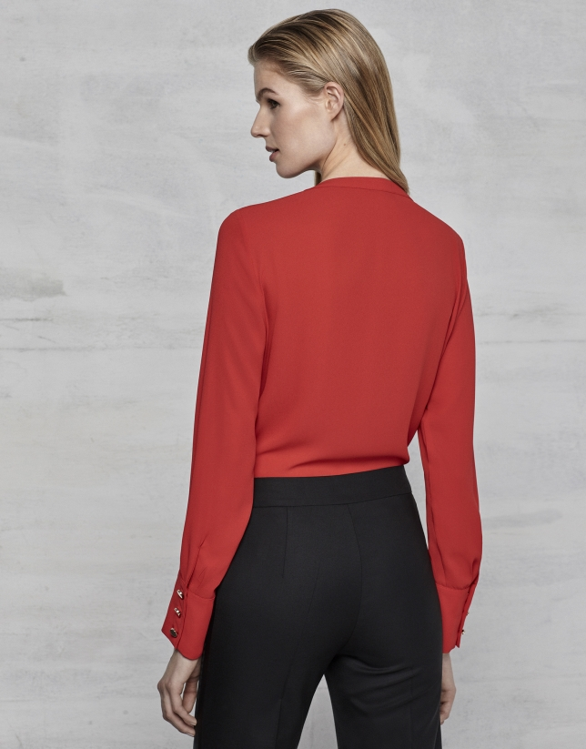 Red blouse with tucks