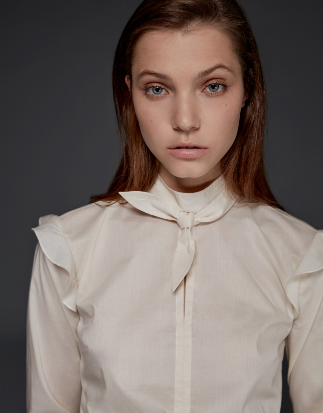 Ivory shirt with shoulder flounces