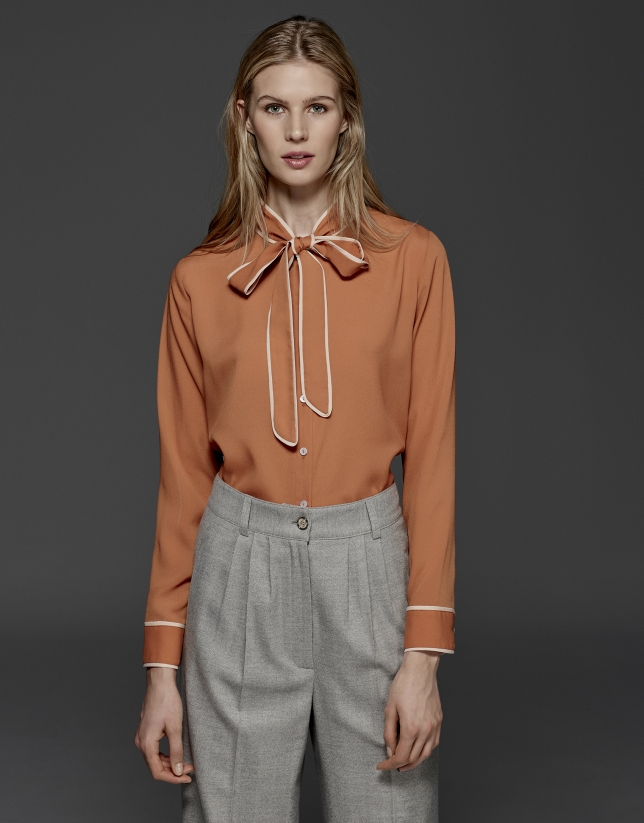 Orange shirt with bow collar