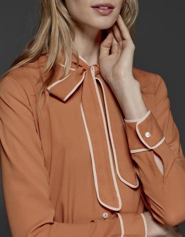 Orange shirt with bow collar