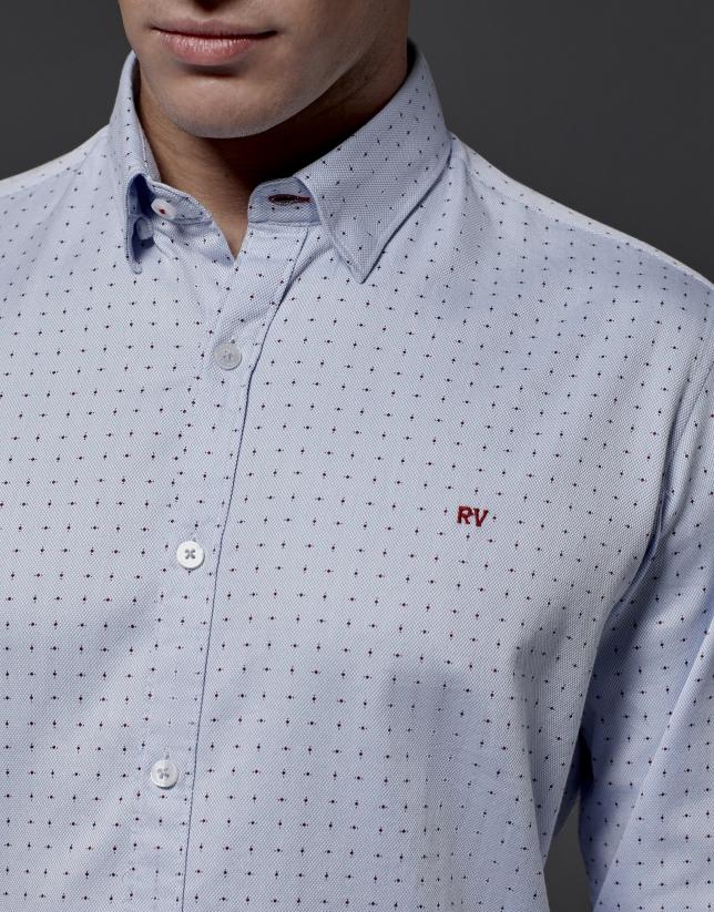 Chemise structurée bleu ciel avec des pois rouges