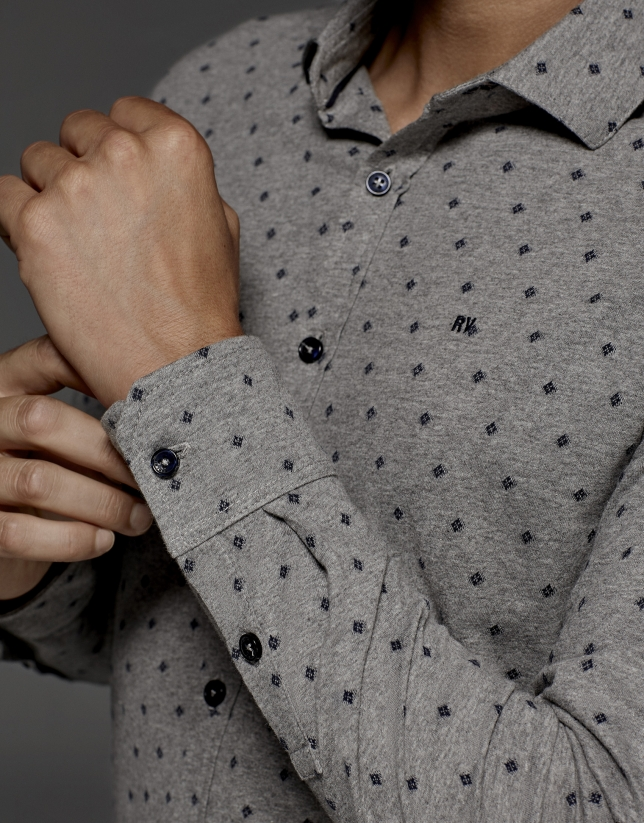 Polo modèle chemise en gris et fantaisie