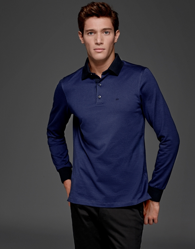 Blue short sleeved polo with navy blue design