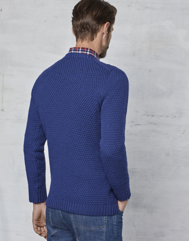 Blue braided and cable-stitched sweater