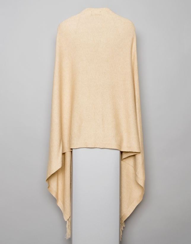 Beige cape with fringe