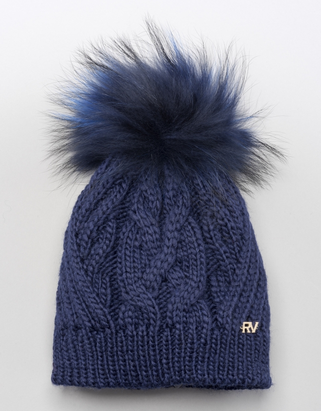 Bonnet bleu torsadé en laine avec pompon