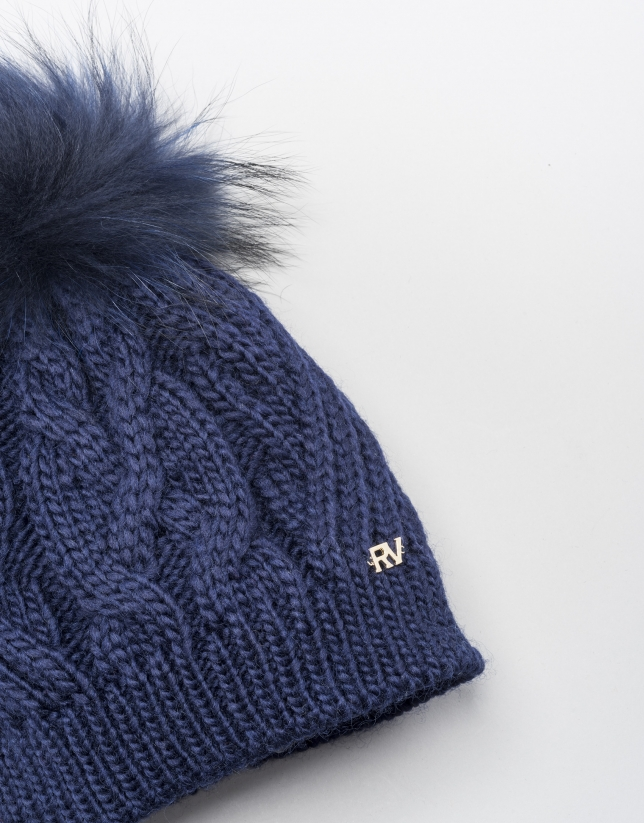 Blue cable knit wool cap with pompom