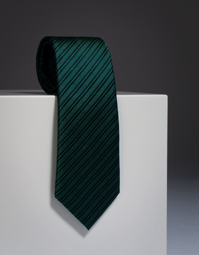 Green silk tie with navy blue stripes