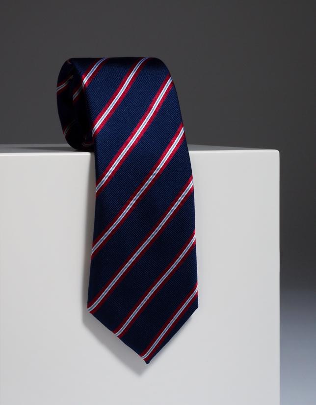 Cravate en soie bleu marine à rayures rouges et écrues