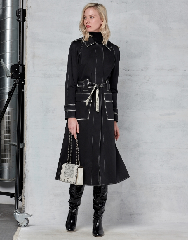Black trench coat with white stitching