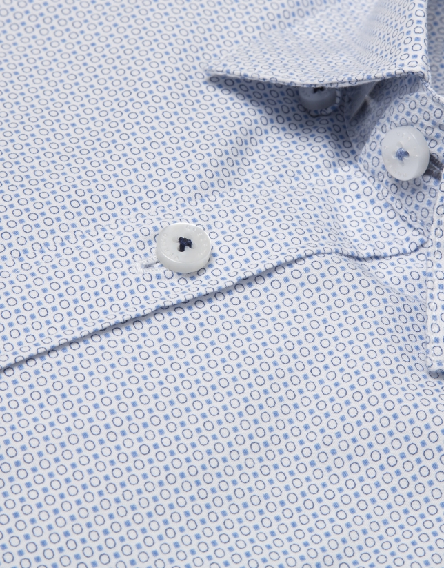 White shirt with blue geometric print