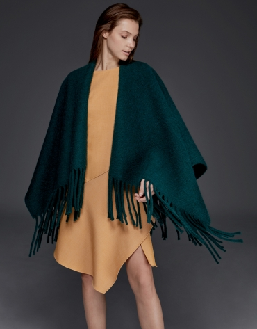 Green poncho with fringe
