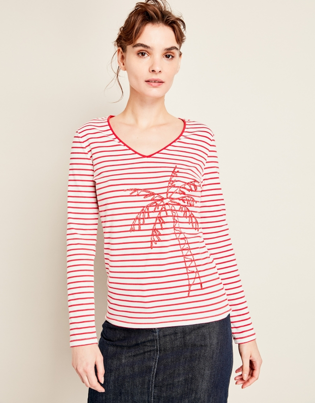 T-shirt à rayures rouges et palmier