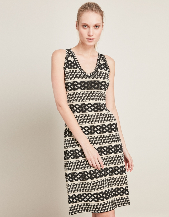 Black knit dress with flounce