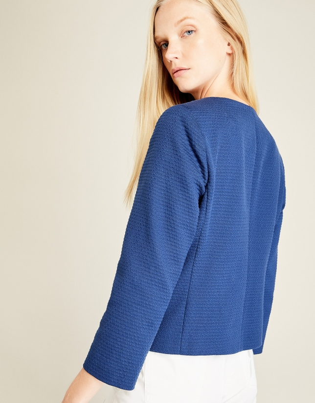 Blue short jacket with pockets