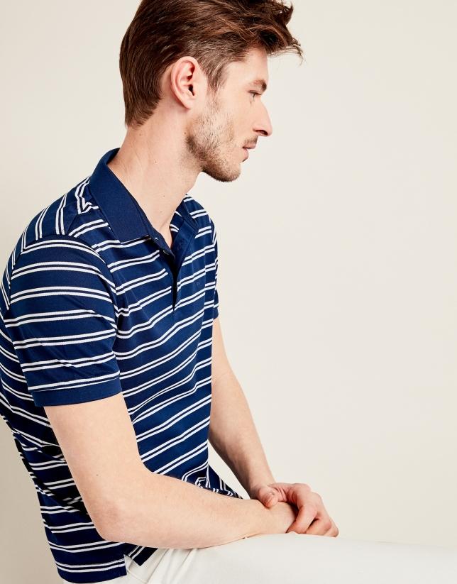 Polo bleu en coton à rayures blanches