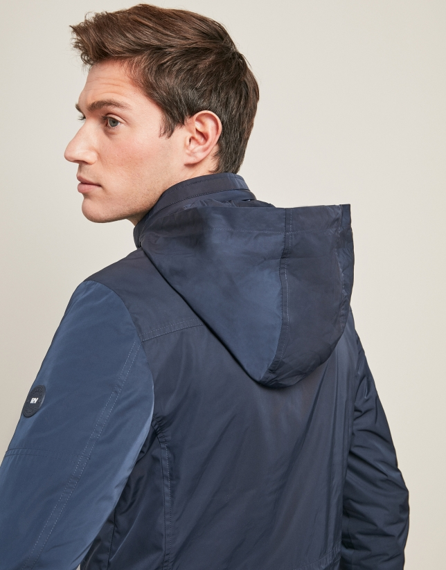 Navy blue parka with four pockets