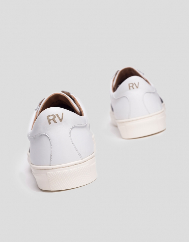 White sports shoes with side panels