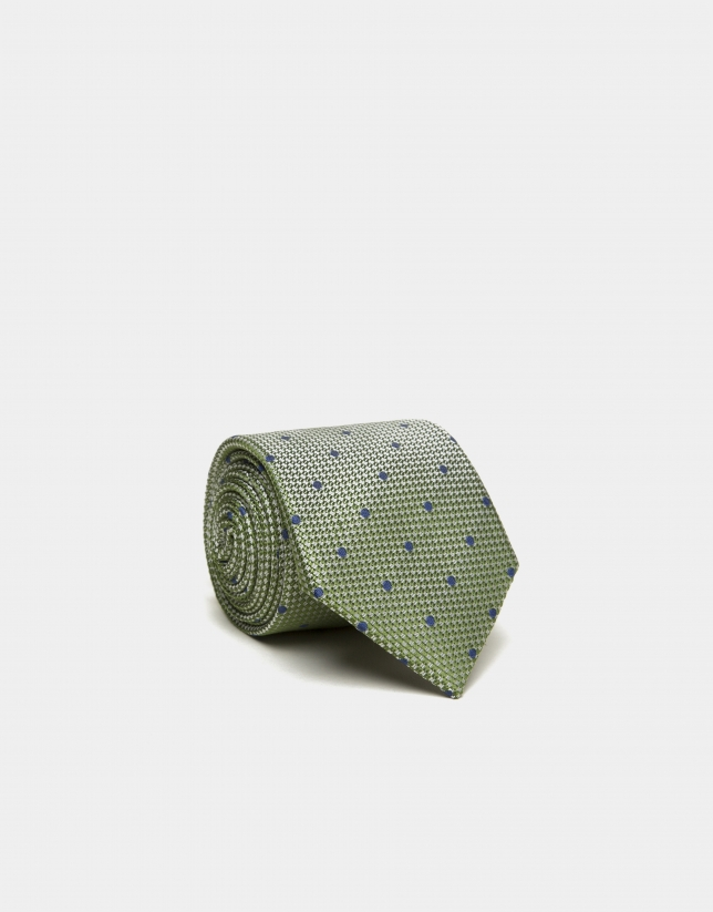 Green silk tie with blue jacquard dots