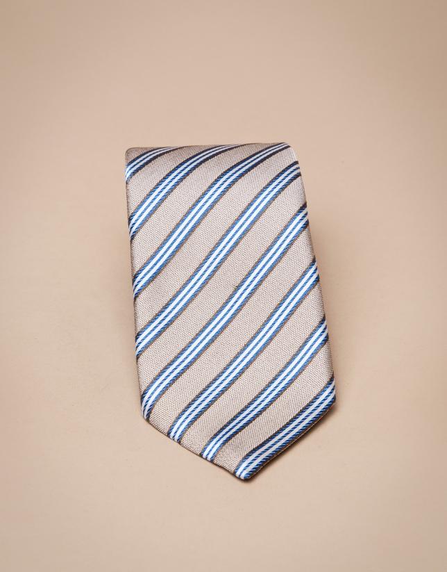 Cravate en soie couleur vison à rayures bleues