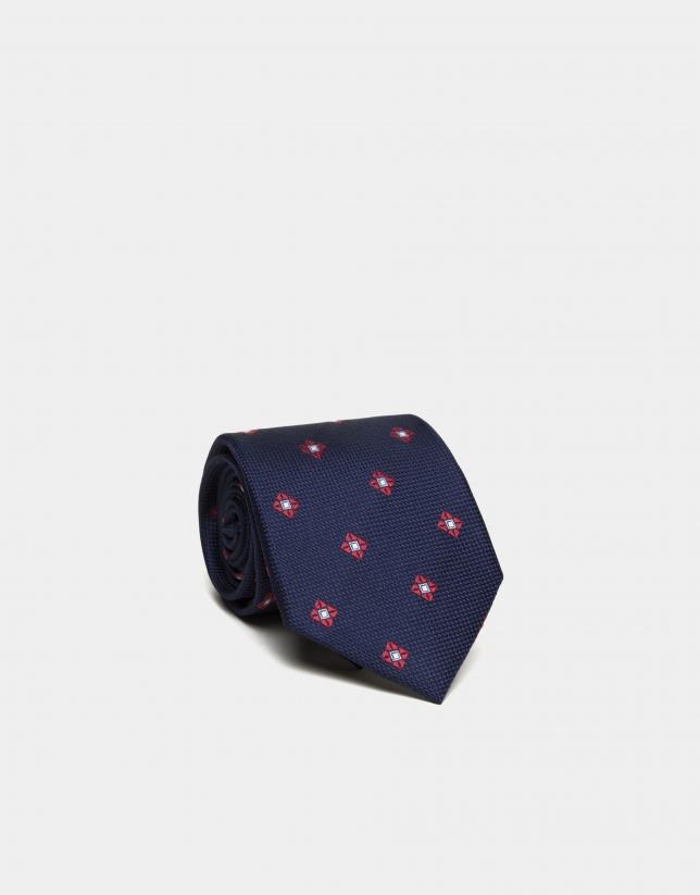 Cravate en soie bleu marine à jacquard de fleur en rouge/écru