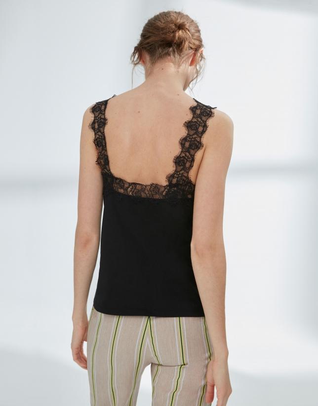 Black top with lace appliqué