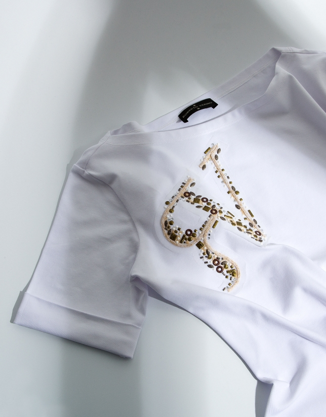 Top with logo and sequins