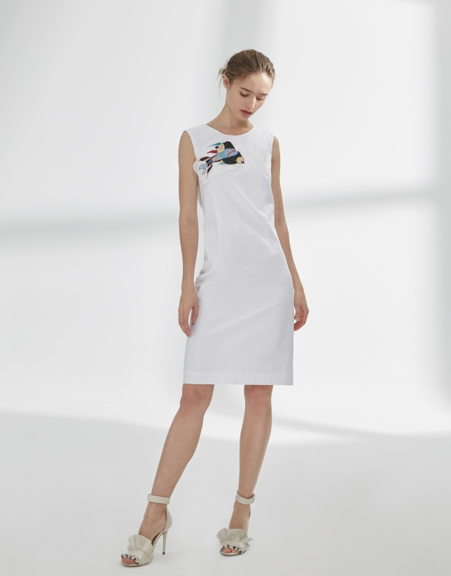 White dress with bow in back