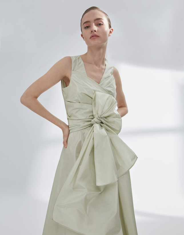 Green draped flowing dress