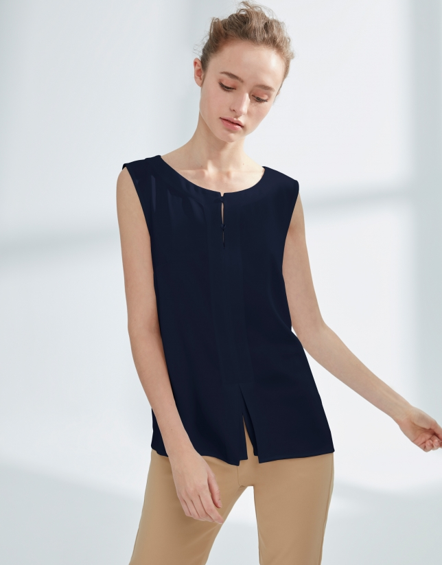 Navy blue top with two buttons
