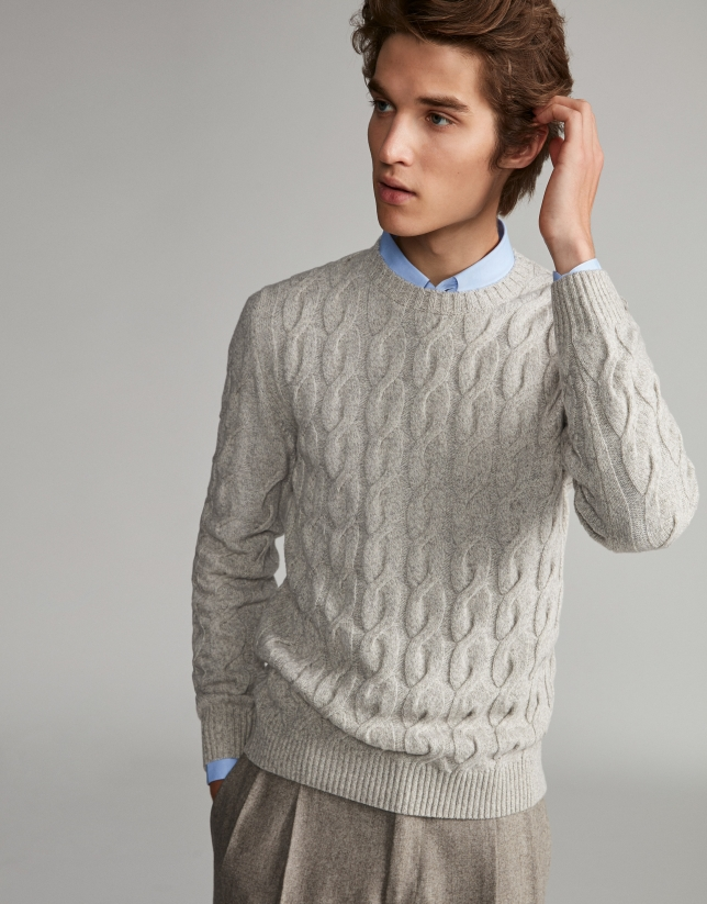 Cream-colored sweater with high collar