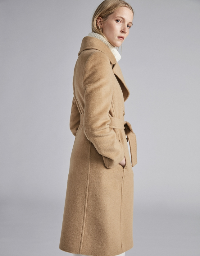 Beige cloth coat with triple row of  buttons