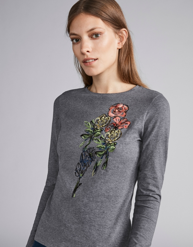 Steel-colored top with floral embroidered print