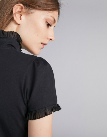 Black short-sleeved top with stovepipe collar